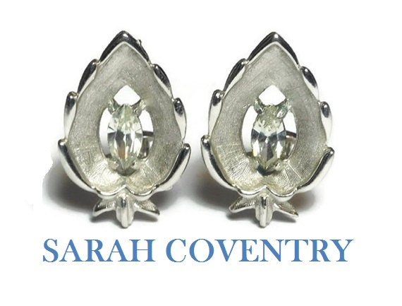 Sarah Coventry earrings,  1960s 'crystal navette', marquise cut rhinestone crystal center, leaf shape, silver clip earrings
