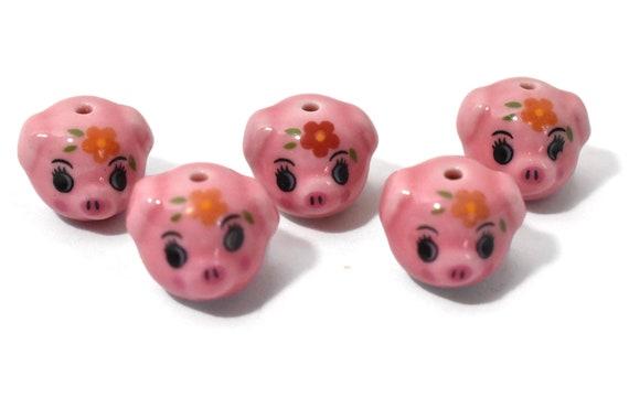 Porcelain pig beads, 4 piece lot, pink piggy figurine beads, ceramic Kawaii beads, four matching 1 has darker flower