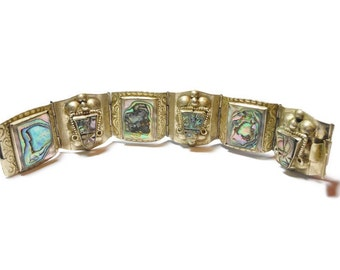 Mexican bracelet, abalone Aztec mask inserts, silver etched link panels marked Hecho en Mexico, Mexico City mark Mexican Eagle