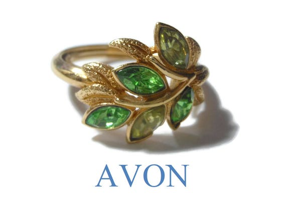 Avon Leaf Lights Ring, adjustable from 6 to 8, 1974 green marquis cut faux emerald & Peridot rhinestone leaves, gold tone setting