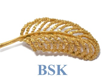 BSK figural leaf brooch with cut out work - diamond cut gold tops make it a real sparkler!