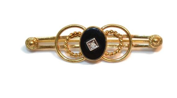 Van Dell bar pin, 14K GF, black onyx cabochon center, small diamond chip, double circles, on a gold bar brooch, tie tack clip clasp 1960s