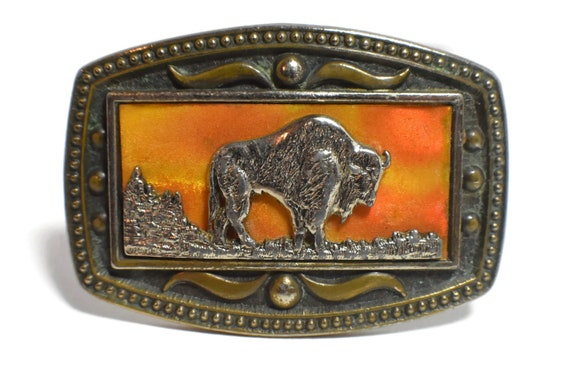 Bison belt buckle, CII New York buffalo belt buckle, orange sunset reflective background on square frame on decorative brass with rope frame