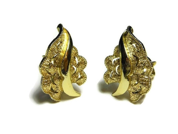 Coro leaf earrings textured leaf with cut outs, clip-on in gold tone
