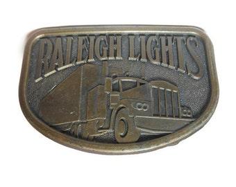 Raleigh Lights belt buckle, brass western belt buckle, antiqued look, trucker belt buckle vintage, signed RJ, 18 wheeler, cigarette ad