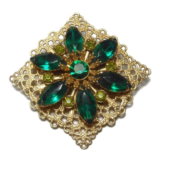 Green rhinestone brooch, dark green navettes, faceted round green chatons, olive green chatons, prong set, gold filigree square brooch pin