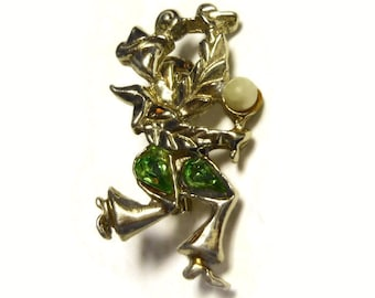 Flamenco dancer brooch pin with maracas and faux pearl and green rhinestones in a light gold tone setting