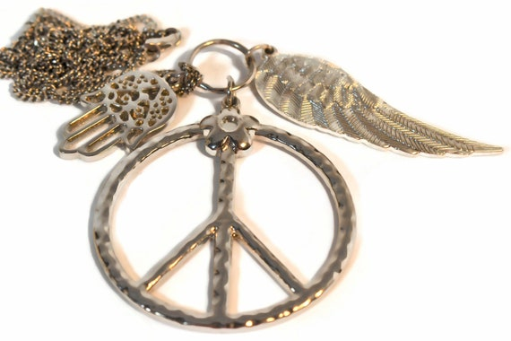 Peace necklace, Peace symbol, Hamsa palm symbol of good fortune, and Wing symbol of freedom pendants on a silver curb chain