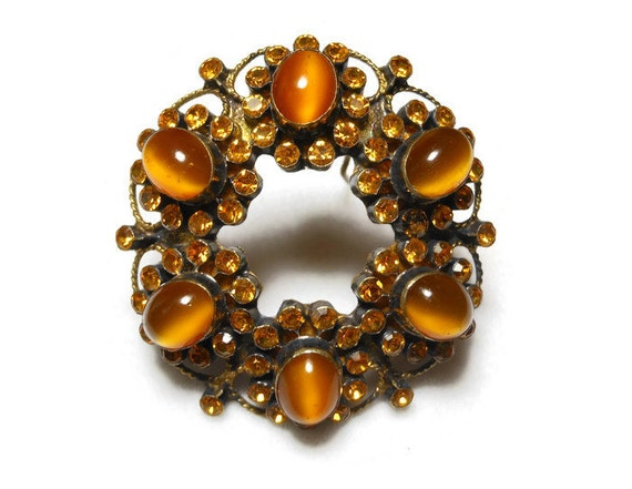Antique rhinestone brooch, Victorian circle pin, amber prong set rhinestones, bezel set amber art glass cabochons, brass