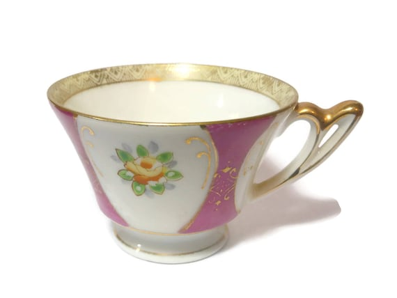 Ucagco bone china cup occupied Japan, 1945 to 1952, floral small tea cup or demitasse cup, tangerine flowers  oval frames mauve background