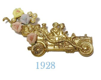 1928 car brooch, touring car automobile with yellow, pink and purple ceramic roses and small faux pearl flower.