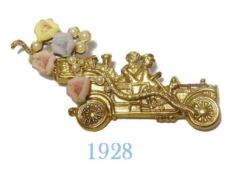 1928 car brooch touring car automobile with yellow pink and image 0