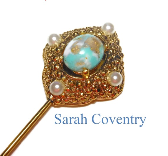 Sarah Coventry stickpin, faux turquoise with glitter cabochon and faux pearls embedded in a gold ornate frame