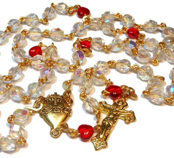 "Aurora Borealis rosary ""Northern Lights"" gold plated wire, AB beads , red heart Pater beads, gold plated center and crucifix"