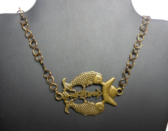 "Double fish necklace, antiqued brass-finished, fish and ingot design, Chinese characters for ""Treasures fill the home"", wire wrapped chain"
