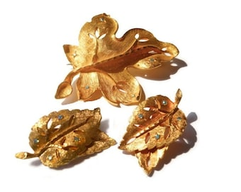 Leaf brooch and earrings, Gold tone leaf design statement brooch and earrings with green faceted rhinestones, quite possibly unsigned BSK