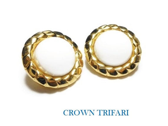 Crown Trifari earrings, 1960s gold circle button earrings with white lucite cabochon center surrounded by gold rope like frame