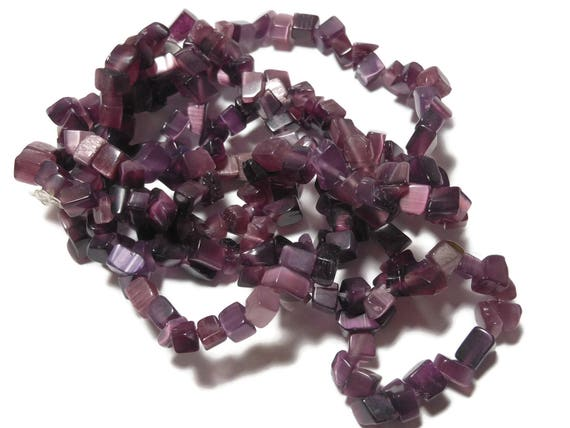 Dark Purple cat's eye glass bead, small chip. Sold per 33-inch strand. Spacer beads, approximately 4 - 7mm
