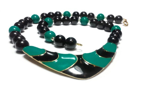Green and black choker, green and black enamel center with gold lines, alternating black green beads and silver spacer beads