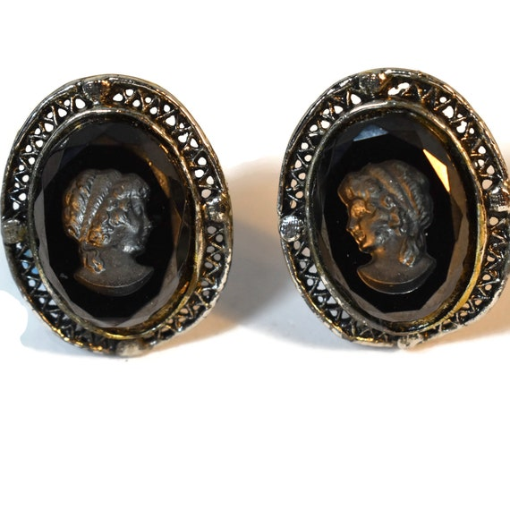 Black glass cameo clip earrings, reverse carved, faceted edges, intaglio, distressed vintage look silver frame, Victorian Mourning Jewelry