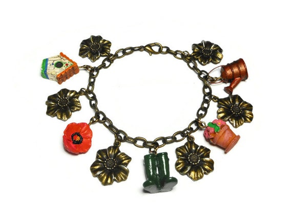 Gardening charm bracelet, upcycled colorful garden charms mixed with bronzed flowers with silver highlights on a bronze link bracelet