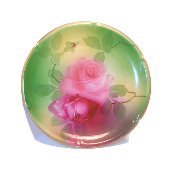 Pink rose plate, signed Imperial Austria Peinture A La Main and Imperial PSL Alma, signed De Fries, green background gold rimmed, c. 1910