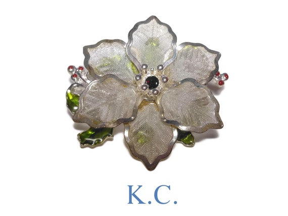 KC silver poinsettia brooch, mesh leaves with ruby colored rhinestone center, green enamel leaves with red enamel berries, floral pin