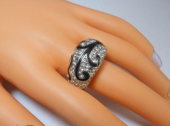 Large rhinestone cocktail ring, black enamel swirls inside clear pave rhinestones, silver plated, size 9