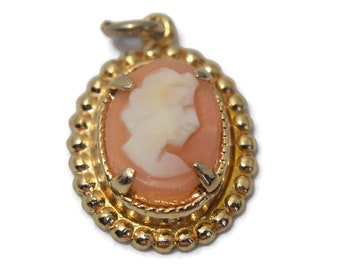 Small cameo pendant, prong-set traditional cameo with white head and braid oval frame