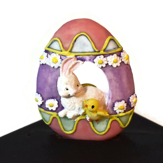 Easter egg brooch, colorful Easter egg with center hole showing a bunny and a chick, riff raff and daisies decorate, purple pink green white