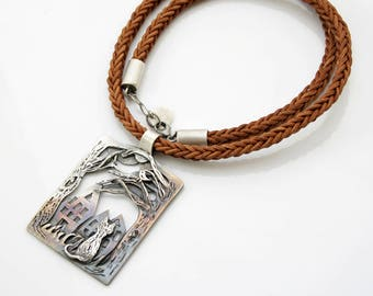 Big, silver pendant with a cat. Hand carved in fine silver. One of a kind silver necklace with leather cord