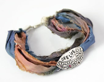 Bracelet made with silver and sari silk bracelet ribbon