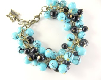 """Turquoise and black cha cha cluster bracelet    (6 1/2 - 7 1/2"""")"""