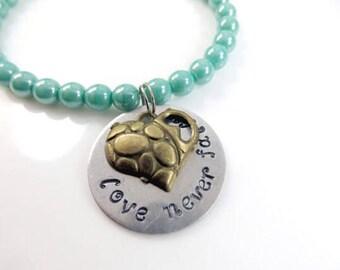 Hand stamped - love never fails - bracelet