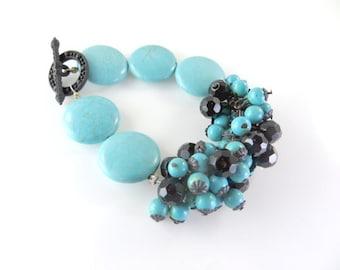 "turquoise mini cha cha cluster bracelet with black   (7 1/2"")"