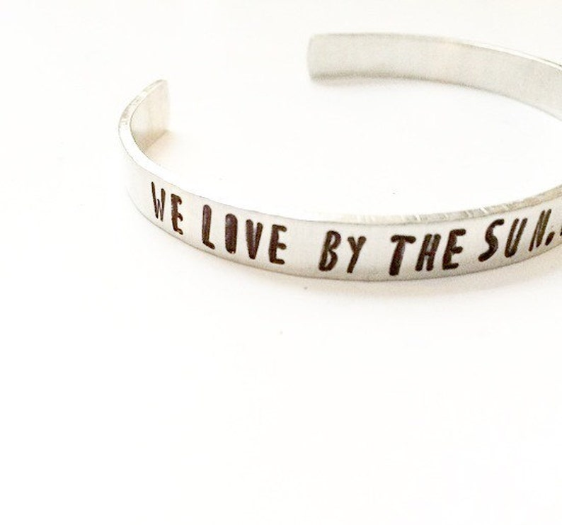We live by the sun we feel by the moon. Sun moon and stars image 0