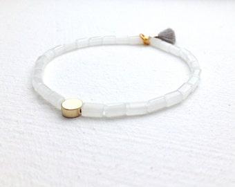 Minimalist bracelet with small tassel