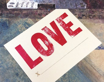 LOVE x _ _ _ Letterpress Printed Postcard in red and antique gold on shimmery shiny gold card stock paper