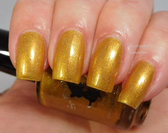 In Just 7 Days - custom gold holographic Rocky Horror inspired nail polish