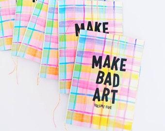 make bad art! volume five. full color a6 zine.