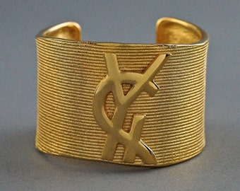 94548e0428d Vintage YVES SAINT LAURENT Ysl Logo Ribbed Gold Cuff Bracelet