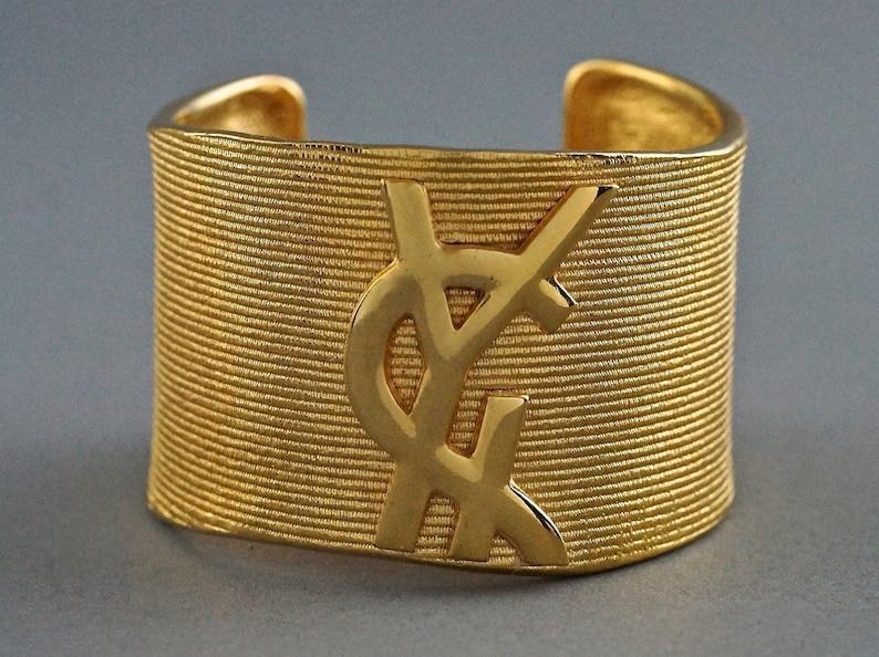 a83b489c290 Vintage YVES SAINT LAURENT Ysl Logo Ribbed Gold Cuff Bracelet | Etsy