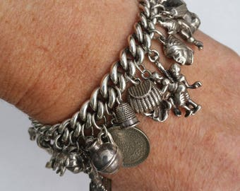 Heavy Charm Bracelet with 24 Charms, 90.4 g . Vintage, Sterling Silver. Hallmarked on each Link