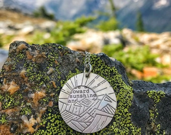 mountain necklace, sun necklace, walt whitman quote, keep your face always to the sunshine and the shadows will fall behind you,
