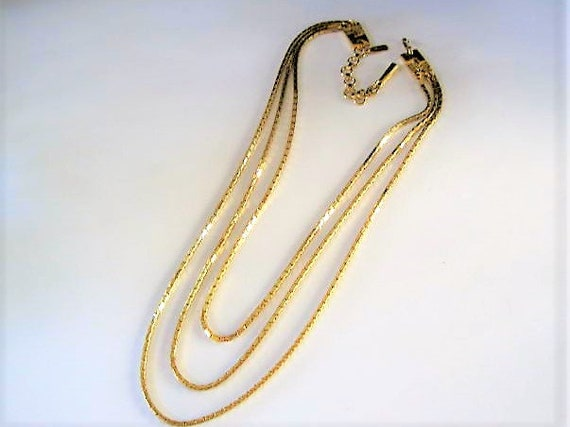 Monet Gold Necklace, 3 Strand, Signed Monet tag,  Gold Chains of Varying Lengths