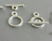 Set of 8 Silver Toned Tog...