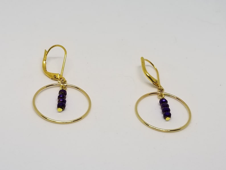 Gold Earrings with Purple Dangles image 0
