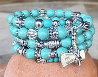 Handmade 4-wrap memory wire bracelet featuring turquoise beads with tibetan silver beads, spacers and tomahawk charm