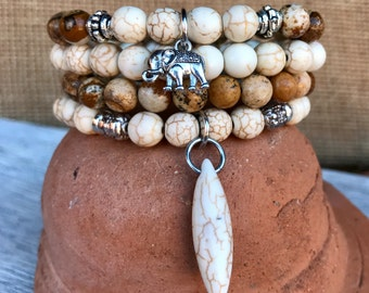 Picture jasper and off-white turquoise boho stacker bracelet set. Rustic 4 stretch bracelet set with lucky elephant and drop charms