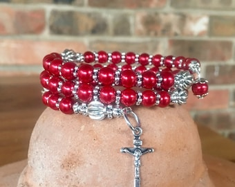 Handmade 5 decade rosary wrap bracelet with red glass pearl and tibetan silver beads. Memory wire cuff bracelet with five decades
